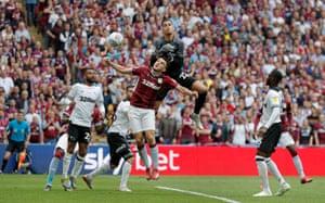 Villa's John McGinn scores the winning goal as Derby keeper Kelle Roos fails to catch a high-ball.