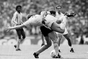 Coventry's Trevor Peake using an unorthodox manner to deal with Spurs' Clive Allen.