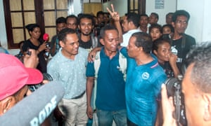 Reporter Raimundos Oki (centre) after his hearing in Dili, Timor-Leste.
