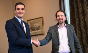 Pedro Sánchez (left) and Pablo Iglesias, leader of Unidas Podemos, shake hands during a press conference in Madrid
