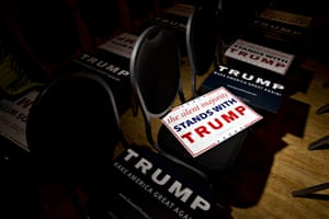 Campaign signs sit on chairs ahead of an event with Donald Trump in Racine, Wisconsin.