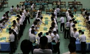 Election staff members count votes, which were cast in the Parliament's upper house election, at a ballot counting center in Himeji, Japan.