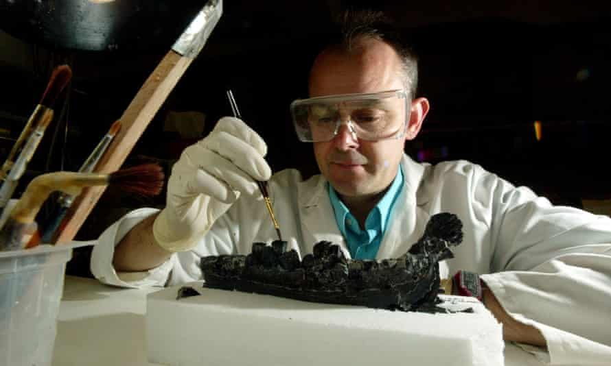 Scientists cultivate painstaking accuracy and attention to detail. Conservation scientist David Gray cleaning a fossil at the Natural History Museum, London.