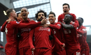 Mohamed Salah (centre) is mobbed by his Liverpool teammates after his superb goal.
