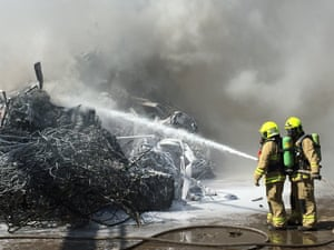 Fire and Rescue NSW officers fighting a fire at a metal recycling plant in St Marys, Sydney, in October.