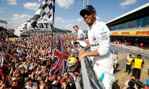 Lewis Hamilton greets the crowd after finishing second in the 2018 British Grand Prix at Silverstone.
