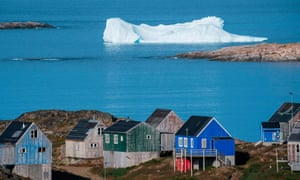 Icebergs float behind the town of Kulusuk in Greenland on August 16, 2019