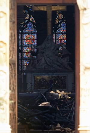 Charred debris litters the interior of the cathedral. Thankfully much of its stained-glass was not damaged