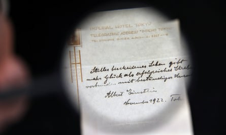 A note written on a Tokyo hotel official paper in 1922 by Albert Einstein is seen before it is sold at an auction in Jerusalem.