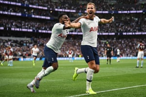 Harry Kane of Tottenham Hotspur celebrates with teammate Danny Rose after scoring his team's second goal.