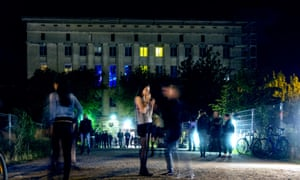 View at night of people waiting outside entrance to the famous Berghain nightclub in Friedrichshain, Berlin, Germany.