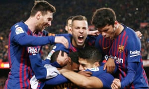Barcelona's players celebrate Luis Suarez's opening goal against Atletico Madrid.