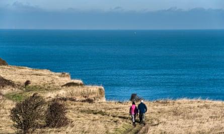 Pair walking towards the sea