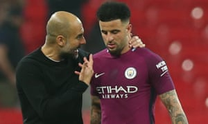 Manchester City manager Pep Guardiola with Kyle Walker.