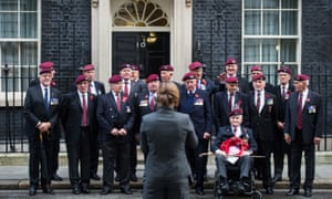 Veterans get their photograph taken at Downing Street before the Remembrance Sunday service at the Cenotaph, London