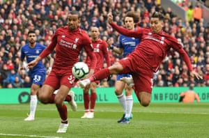 Firmino stretches to prod the ball towards goal.
