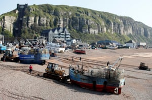 A boat from the Hastings land-based fishing fleet is launched from the town's beach