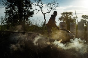 A charcoal burner distributes earth on the charcoal mound
