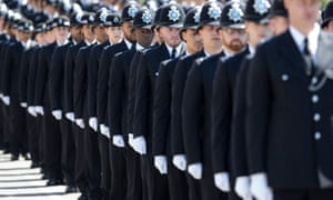 Police cadets who have completed their training take part in passing out parade in east London.