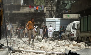Syrians gather at the site of airstrikes in a rebel-held neighbourhood in Aleppo, Syria, after attacks on Thursday.