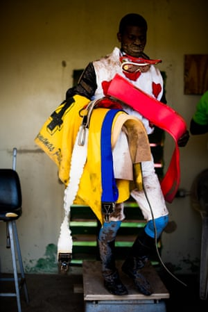 Jockey Bebeto Harvey at the weigh out with all his kit, to confirm that during the race his horse carried the right weight
