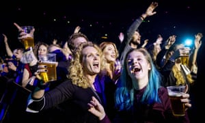 Visitors to the Ziggo Dome attend a performance by Dutch singer Andre Hazes part of a series of trial events in which Fieldlab is investigating how large events can take place safely in corona time in Amsterdam on 7 March 2021