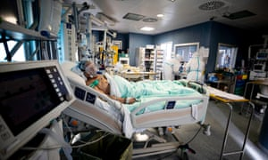 A patient in the intensive care unit in a Rome hospital.