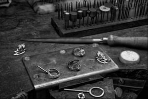 An assortment of precious jewels designed by Stephen Webster, founder and creative director of Stephen Webster and one of the first jewellers to use Fairtrade gold, are displayed on a workbench in his studio.