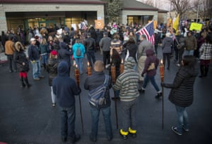 Anti-maskers, some carrying tiki torches, protest at the Central District Health offices during a special meeting of the board to decide on new mask mandates Friday, 4 December, 2020 in Boise, Idaho.