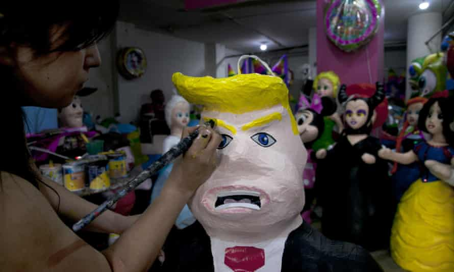 A woman working on a Donald Trump piñata in a store in Mexico City