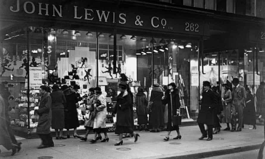 Passers-by outside John Lewis in Oxford Street, London, December 1936.