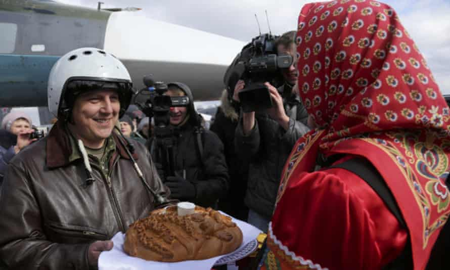 A Russian pilot returns from Syria to a traditional welcome of bread and salt at an airbase near Voronezh.