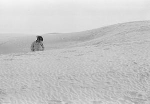 Cowboy in dunes, White Sands National Park, USA, 1963