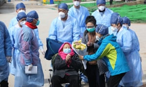 A recovered patient, aged 98, is discharged from Leishenshan Hospital, the makeshift hospital for the COVID-19 coronavirus patients, in Wuhan in China's central Hubei province on Sunday.