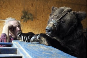 Volgograd, Russia. Animal tamer Pavel Kudrya with one of the two bears he has been keeping at his home since their show was cut from the Russian State Circus Company