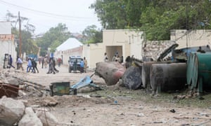 Police survey the scene after a suicide car bomber drove into a checkpoint near the port in Mogadishu.