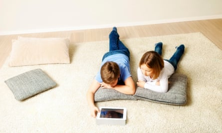 Children using a computer at home.