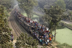 Muslim devotees travelling on the train after attending the Akheri Munajat, concluding prayers on the third day of Biswa Ijtema on the outskirts of Dhaka