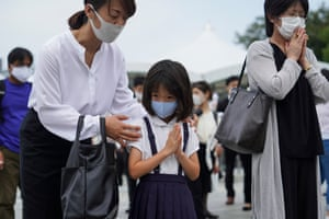 A young girl is accompanied by her mother
