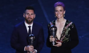 Lionel Messi and Megan Rapinoe pose with their awards.