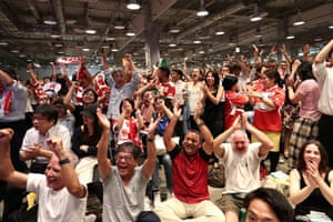 Japanese fans celebrate in the fanzone.