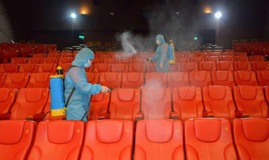 Staff disinfect the seats before reopening a cinema in Kuala Lumpur, Malaysia, at the end of June