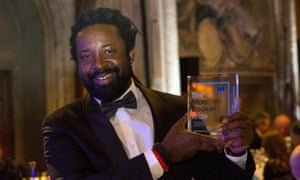 Marlon James poses with his award at the 2015 Man Booker prize ceremony.