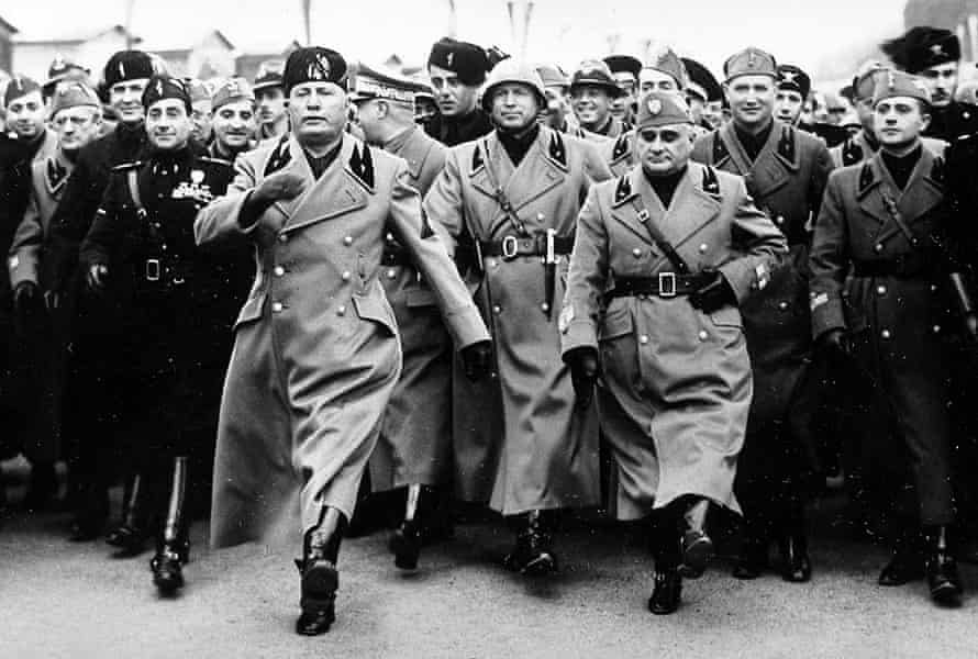 Italian dictator Benito Mussolini (foreground centre) joins in a rehearsal march for a military parade in honour of Hitler's visit to Rome, January 1938.