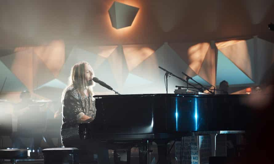 Tim Minchin performs at a livesteamed concert in Sydney on 19 November.