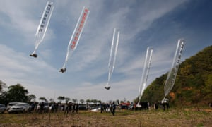 Members of Fighters for Free North Korea, an organisation of defectors from North Korea, send balloons carrying anti-Pyongyang leaflets across the border from the South Korean border city of Paju