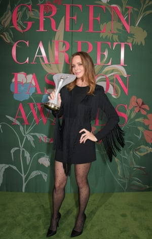 """Stella McCartney wearing a black fringed dress from the Stella McCartney Autumn 2019 collection. The designer was the recipient of the groundbreaker award, and revealed she was wearing a """"100% sustainable viscose dress"""". During her acceptance speech, she said she wanted """"a better planet for our babies""""."""