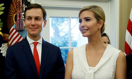 Jared Kushner and Ivanka Trump stand together in the Oval Office of the White House.