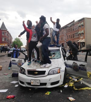 Protesters on hood of Baltimore police car