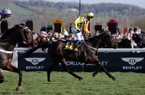Paul Townend crosses the finishing line on Al Boum Photo to beat Santini (left) and win the Gold Cup for the second consecutive year.